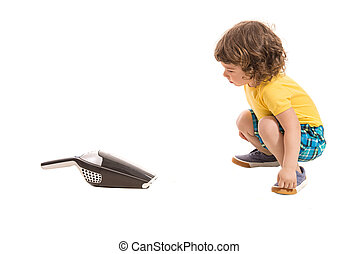 Boy amazed by hand-held vaccum cleaner