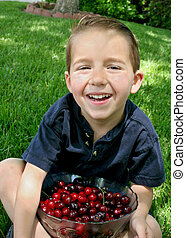 Boy and a bowl of cherries 1
