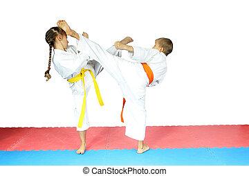 Boy and a girl in karategi