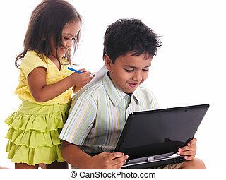 boy and a girl with a laptop - Asian boy and a girl with a...