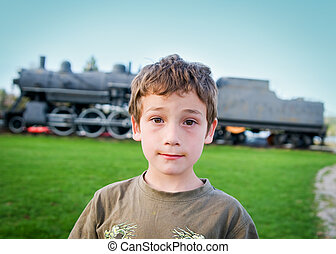 boy and an old steam engine