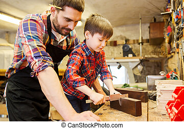 boy and dad with calipers measure wood at workshop