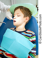 Boy and dentist during a dental procedure