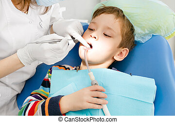 Boy and dentist during a dental procedure