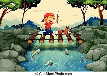 Boy and dog crossing the bridge