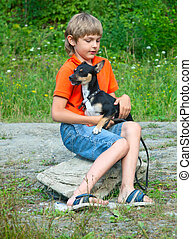 Boy and dog in nature.