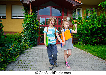Boy and gerl go to school having joined hands.