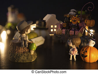 boy and girl are hesitating to join fun of Halloween festival party house which is full with ghosts and monsters. Festive Celebration, Holidays, Fun, Halloween toy and doll decoration theme concept.