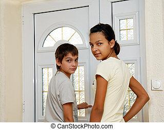 Boy and girl by door