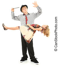 Boy and Girl Child Magic Show Levitation. - Attractive teen...