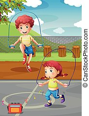 Boy and girl doing jumprope in the park