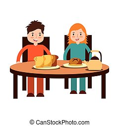 boy and girl eating breakfast
