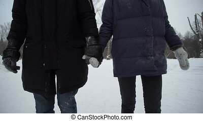 Boy and girl go and holding hands