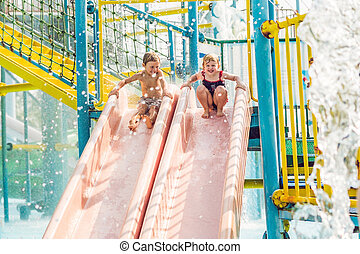 Boy and girl have fun in the water park