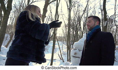 Boy and Girl Having Fun with Snow
