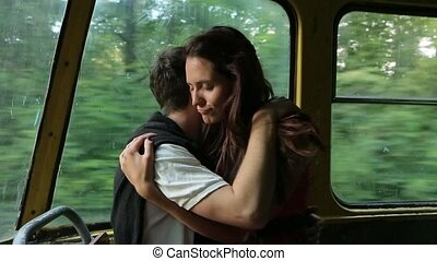 Boy and girl hugging in the tram