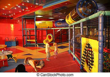 boy and girl in playroom