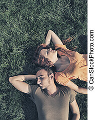 Boy and girl in the grass