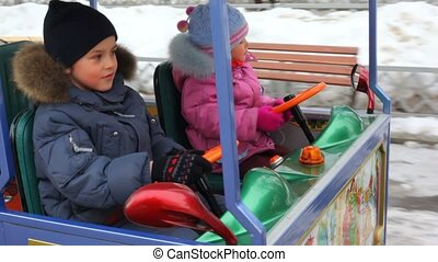Boy and girl in the kids railroad. winter