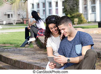 Boy and girl looking at tablet