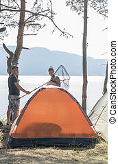 Boy and girl on a campsite