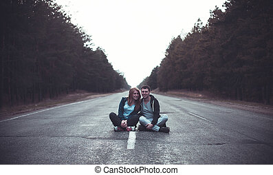 Boy and girl on a road