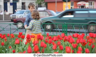 boy and girl play on street