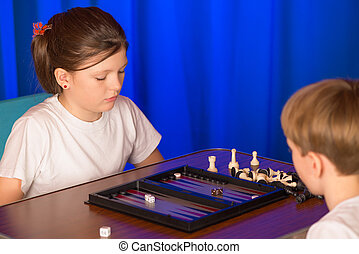 Boy and girl playing a board game