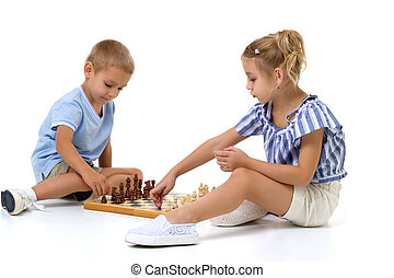 Boy and girl playing chess board game