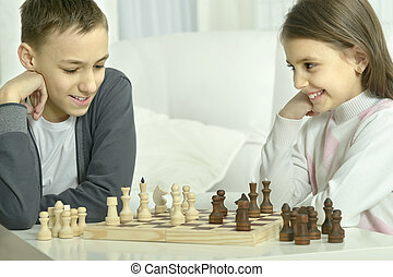 boy and  girl  playing chess