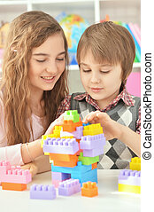 Boy and girl playing lego game