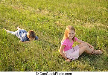 Boy and girl resting in a meadow