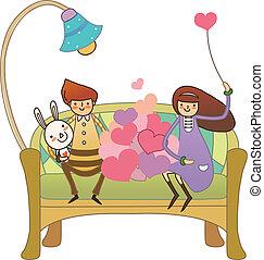 Boy and Girl sitting on sofa