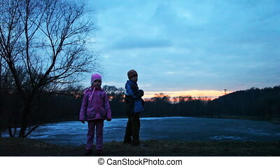 boy and girl stand in wood, father with chinese lantern, part1