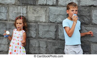boy and girl standing, eat ice cream