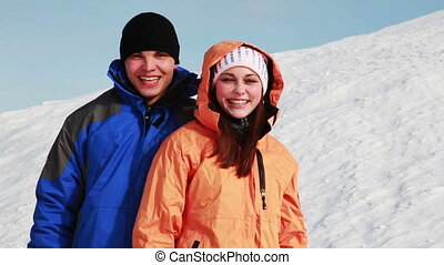 boy and girl standing outdoors in winter