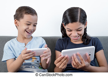 Boy and girl using mobile and table