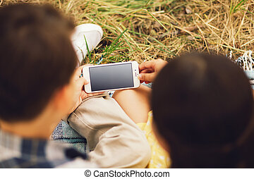 Boy and girl using smartphone. - Shot of boy and girl using...