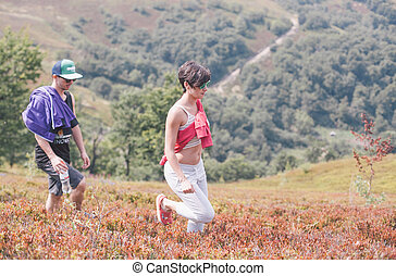boy and girl walking in the mountains