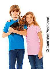 Boy and girl with cute little dog