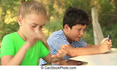 boy and girl with digital tablet - Closeup outdoor portrait...