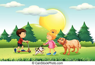 Boy and girl with pets in the park