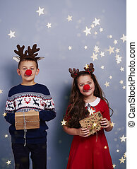 Boy and girl with reindeer antler holding gift box