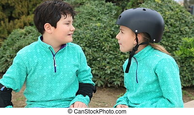 Boy and girl with roller skate