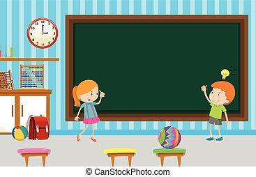 Boy and girl writing on blackboard in classroom