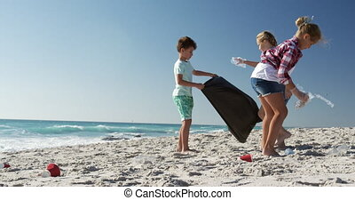 Boy and girls enjoying their time on the beach together - ...