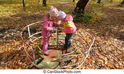 boy and girls playing on playground
