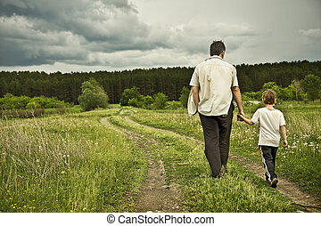 boy and his father are on the road