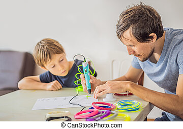 Boy and his father using 3d printing drawing pen. Creative, leisure, technology education concept