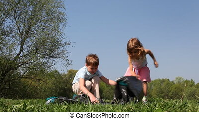 Boy and little girl begins to unfold tent